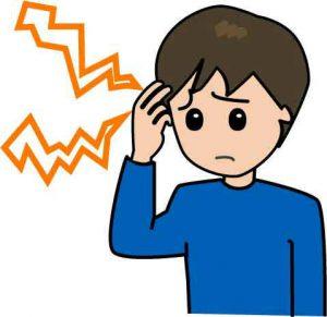 頭痛で困っている男性のイラスト